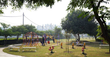 kids playing on the swings in the park in ambala vatika city central an integrated community living project by vatika group