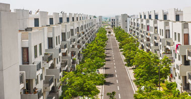 a street view with duplexes of vatika emilia, iris & primrose independent floors on both the sides of the street a project in vatika inxt developed by vatika group