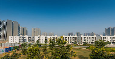 a distant view of duplexes of independent floors project in vatika inxt developed by vatika group