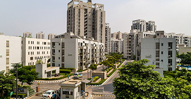 a view of high & low rise towers of lifestyle homes in vatika inxt a project by vatika group