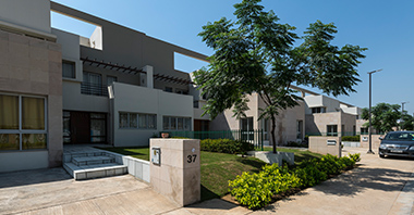 an outside view of the garden & frontside of the signature villa a project in vatika inxt  by vatika group