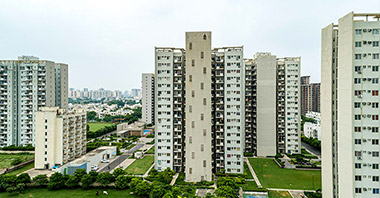 """a view of three towers of seven lamps located in vatika inxt a project by vatika group"