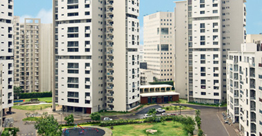 an aerial view of the park & the buildings of the sovereign apartments in gurgaon a project by vatika group