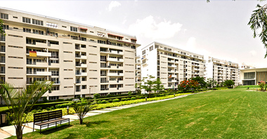 a view of garden & the buildings of vatika city in gurgaon a project by vatika group