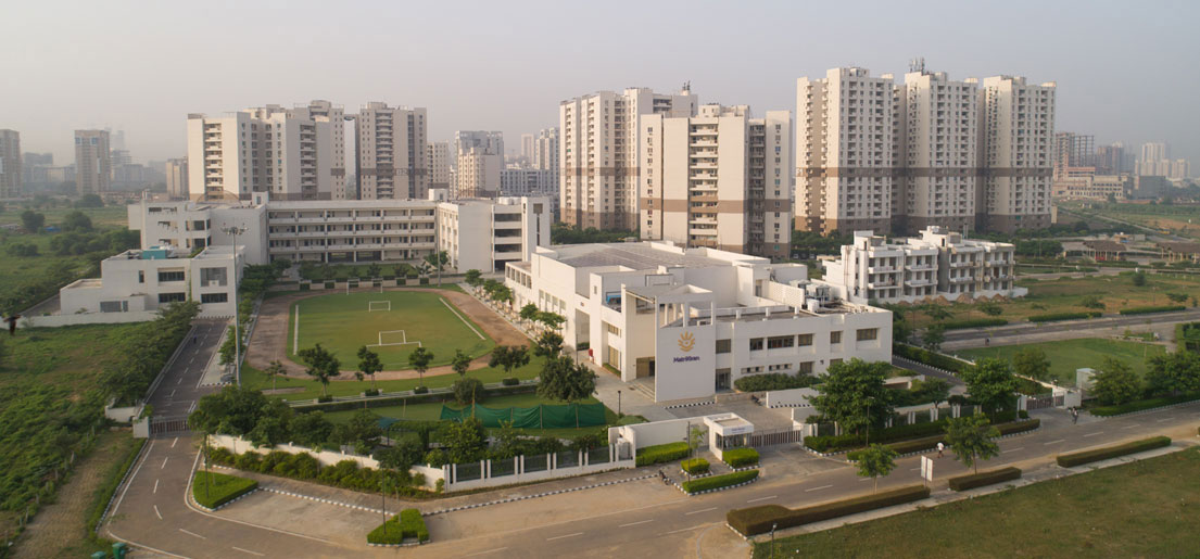 front overview of matrikiran school with gurgaon 21 in the background in vatika inxt by vatika group
