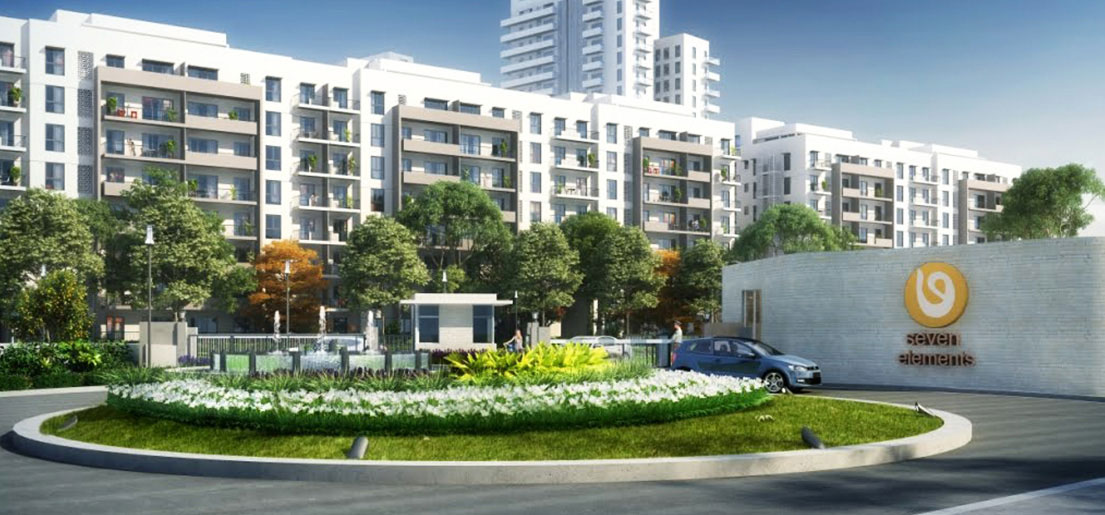 a rendering of a view of the vatika seven elements project from outside the gate a project by vatika group