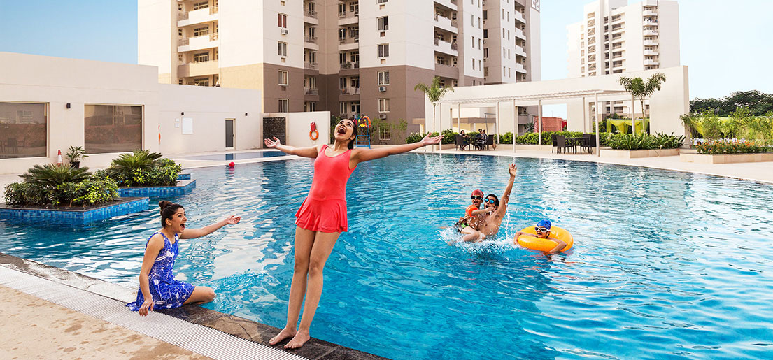 woman falling into swimming pool enjoying with family in gurgaon 21 by vatika india next by vatika group